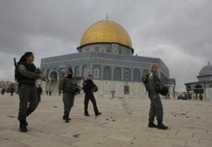 Israeli border police officers walks in front of the Dome of the Rock in Jerusalem's Old City